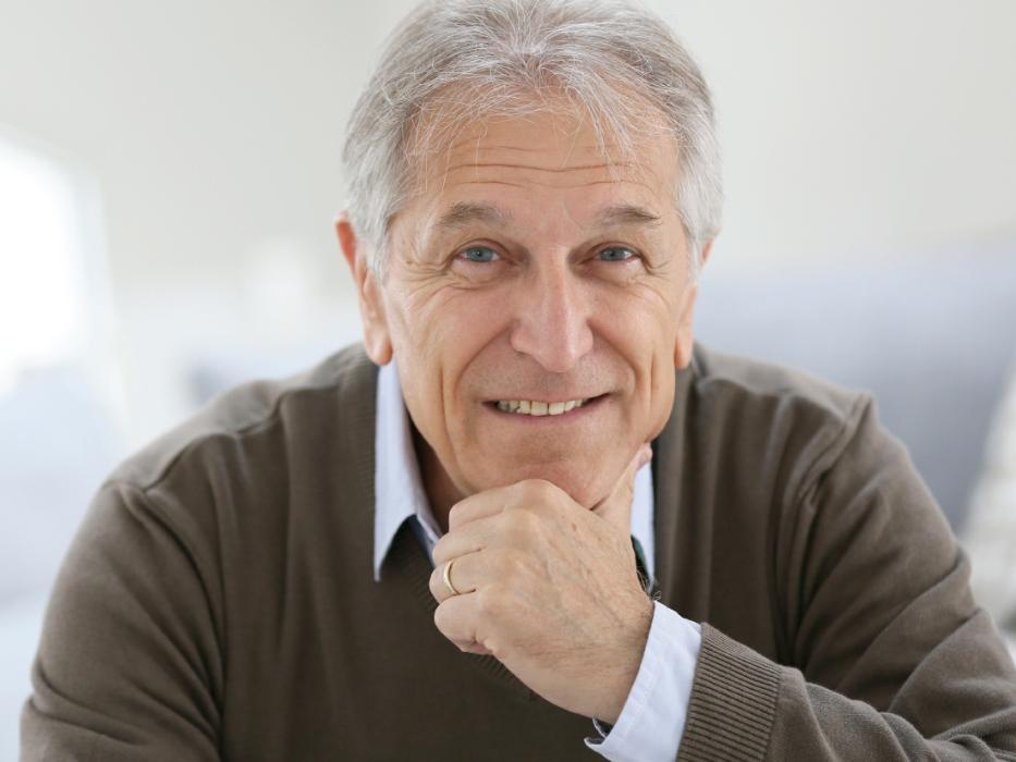 man with grey hair smiling l cosmetic bonding wilmington