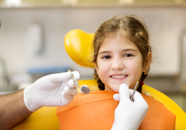 little kid in dental chair