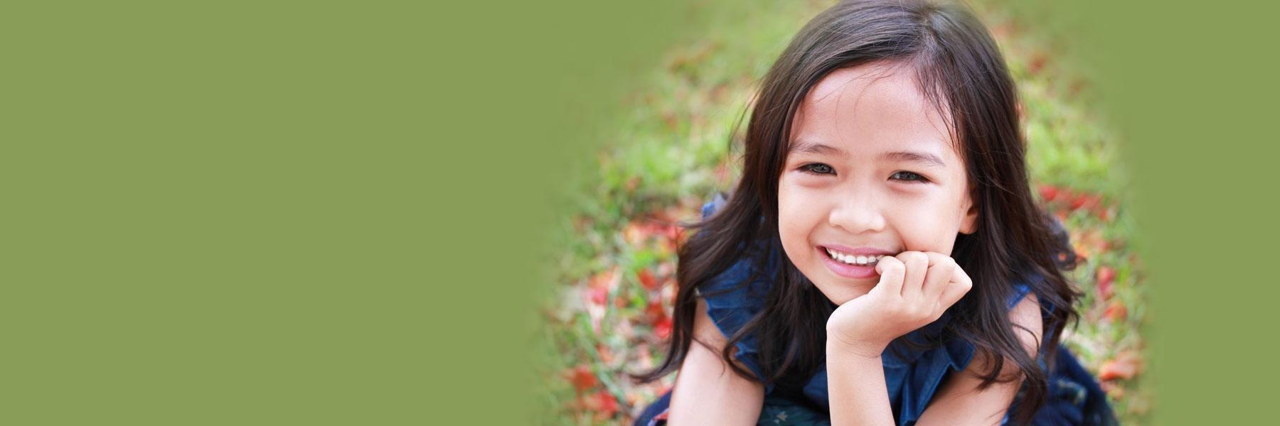young girl smiling outside | pediatric dentistry wilmington de