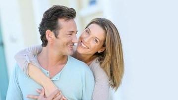 young couple laughing & smiling l dentist wilmington